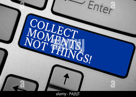 Word writing text Collect Moments, Not Things. Business concept for Happiness philosophy enjoy simple life facts Grey silvery keyboard with bold blue  - Stock Photo