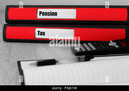 Red folders with pension and tax written on the label on a desk with selective colour - Stock Photo