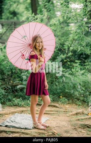 Pre teen girl outdoors - Stock Photo