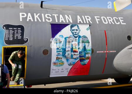 Pakistan Air Force Lockheed C-130E Hercules on static display at the Riat with a colourful paint scheme celebrating No.6 Squadron 75th Anniversary - Stock Photo
