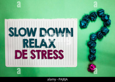 Conceptual hand writing showing Slow Down Relax De Stress. Business photo text Have a break reduce stress levels rest calm white notepad with words te - Stock Photo