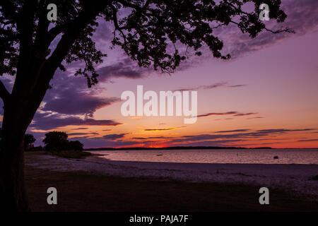 Sonnenuntergang über der Ostsee in Bandholm - Stock Photo