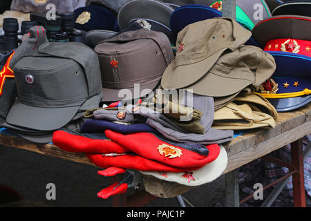 Sale stand of Soviet and DDR militaria near Checkpoint Charlie in Berlin, Germany. - Stock Photo