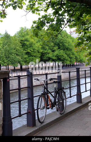 bike standing at a railing on a promenade on the banks of the River Spree - Stock Photo