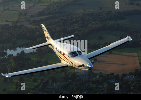 Farnborough F1 Kestrel prototype flying over fields and trees - Stock Photo