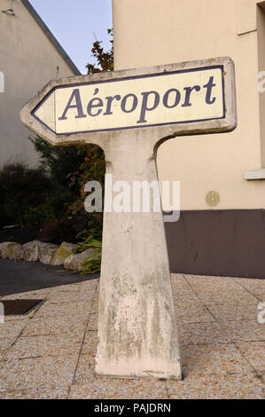 concrete road sign to the airport / Aeroport near Calais, France - Stock Photo