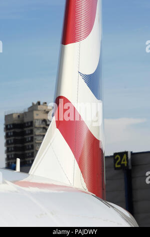 tail-fin on British Airways BA CityFlyer Embraer 170-100STD parked - Stock Photo