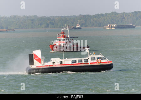 Changi-Airport Emergency Service brand-new Griffon Hoverwork 8000TD rescue hovercraft flying across the sea of the Straits of Singapore - Stock Photo