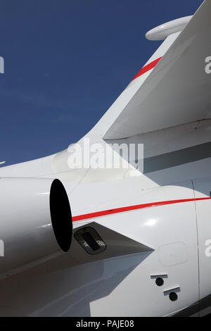 Pratt & Whitney PW307A engine-exhaust, tail-fin, horizontal-stabiliser and antenna of Dassault Falcon 7X parked in the static-display at the Singapore - Stock Photo