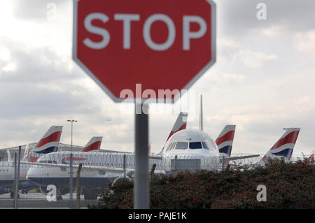 stop sign with British Airways Airbus A321-200, A320s and A319s parked during the strike by British Airways cabin-attendants of the Unite trade-union  - Stock Photo