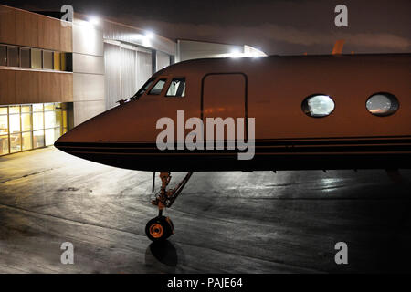 nose of Jetstar Air Grumman G-1159 Gulfstream 2 / II parked at night - Stock Photo