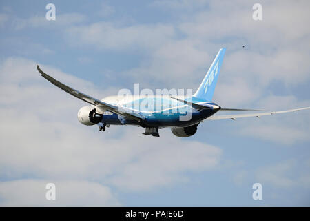 the first Boeing 787-8 Dreamliner prototype taking-off with undercarriage retracting - Stock Photo