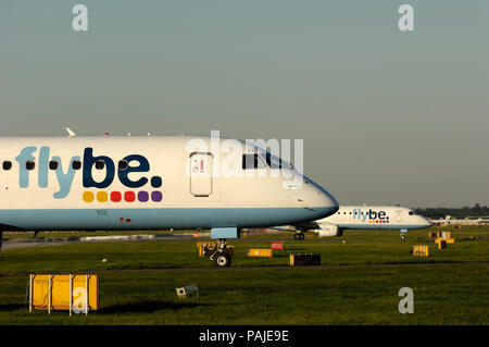 Flybe British European Embraer 195s taxiing at Gatwick - Stock Photo