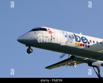 Flybe British European Bombardier DHC-8 Q400 on final-approach at Gatwick - Stock Photo