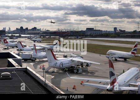 CityJet BAE Avro RJ-85s, Fokker F-50, Swiss BAE 146 Avro RJ-100 parked, Lufthansa Cityline BAE Avro RJ-100 and British Airways BA CityFlyer Embraer 17 - Stock Photo