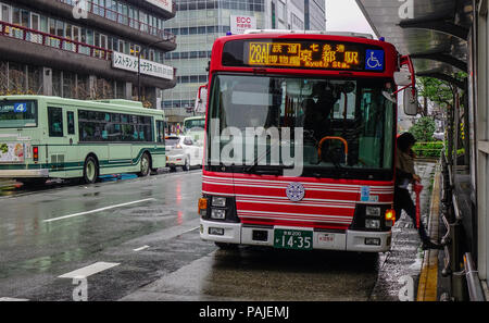 Kyoto, Japan - Nov 27, 2016. A bus stopping at station in Kyoto, Japan. Most cities in Japan are covered by local bus networks. - Stock Photo