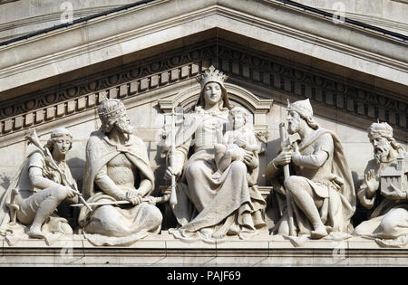 Tympanum bass relief showing the Virgin Mary and Hungarian saints, St. Stephen`s Basilica in Budapest, Hungary - Stock Photo