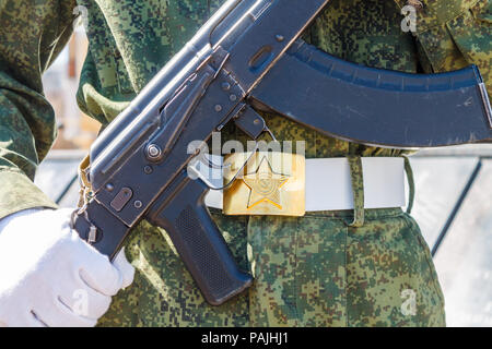 The Russian soldier with a Kalashnikov AK 74 gun in his hands. - Stock Photo