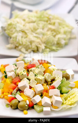Greek salad with feta cheese and olives - Stock Photo