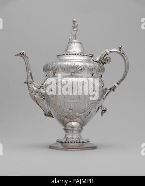 Teapot. Culture: American. Dimensions: 11 1/4 x 9 15/16 in. (28.6 x 25.2 cm). Maker: Wood and Hughes (1845-99). Date: 1862-63.  Presented to Christian Dorflinger upon his retirement from the Long Island Flint Glass Works in 1863, this service (2006.90.1-4) is ornamented with meticulously chased scenes of the glassworks itself. The teapot depicts a back courtyard of the factory, with a loading dock and packing barrels, while the cream pot (2006.90.2) features a vignette of a gaffer at his bench finishing a blown glass pitcher. The finials, cast in the form of glassblowers, also reference Dorfli - Stock Photo