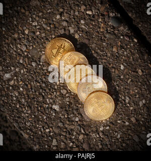 Belgrade, Serbia - June 12, 2018: Golden Bitcoin Coins on ground. Crisis concept.'nThe Bitcoin was invented by Satoshi Nakamoto in 2008 as a digital f - Stock Photo