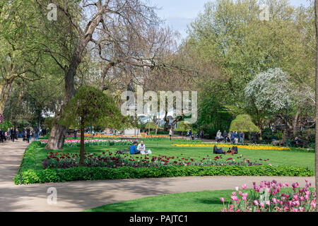 image of people in a London park in the spring of 2017 - Stock Photo