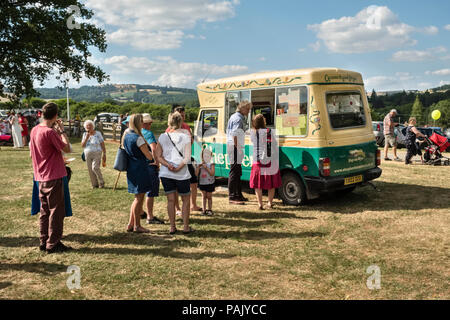 Presteigne, Powys, UK. A queue for ice creams at the local carnival during the heatwave of 2018 - Stock Photo