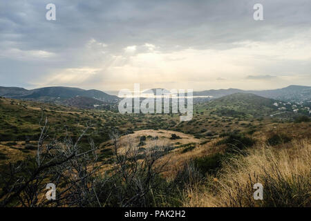 Mountainous landscape looking out towards Fokaia and Saronic Gulf, showing signs of regrowth and adaption from previous wildfire. East Attica, Greece. - Stock Photo
