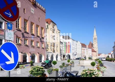 Neuötting: main street Ludwigstraße, church St. Nikolaus in Germany, Bayern, Bavaria, Oberbayern, Upper Bavaria - Stock Photo