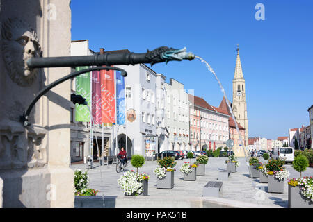 Neuötting: main street Ludwigstraße, church St. Nikolaus, fountain in Germany, Bayern, Bavaria, Oberbayern, Upper Bavaria - Stock Photo