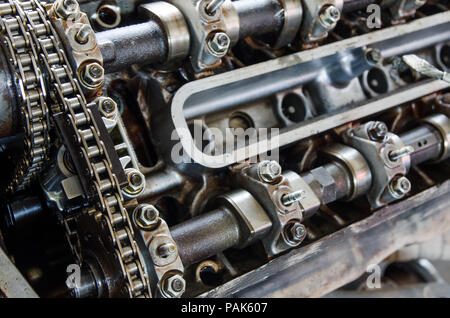 Engine block open exposing the interior distribution chain and pistons with an industrial look - Stock Photo