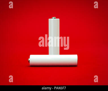 Important power source suggested by two white recheargeable batteries with room for text on them - Stock Photo