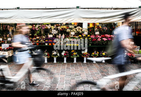 Bolzano. 23rd July, 2018. Photo taken on July 23, 2018 shows a market in Bolzano, north Italy. Bolzano is located in the Trentino-Alto Adige region. It was once a stop on the coach route between Italy and the flourishing Austro-Hungarian Empire. The city is blended with cultures. Thanks to the cool weather, Bolzano attracts lots of tourists during summer time. Credit: Jin Yu/Xinhua/Alamy Live News - Stock Photo