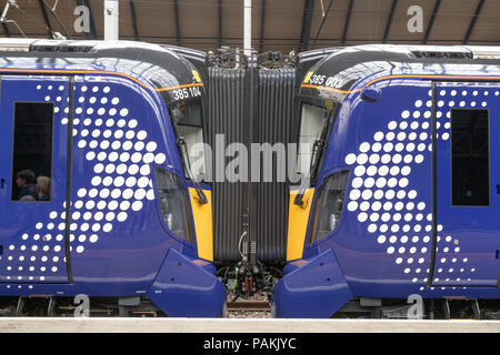 Scotrails brand new Class 385 train at Glasgow Queen Street Station make their debut journey carrying passengers. - Stock Photo