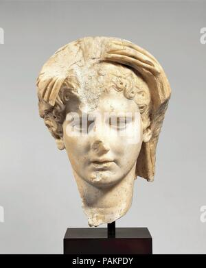 Marble head of a veiled man. Culture: Roman. Dimensions: H. 10 in. (25.4 cm). Date: 1st half of 1st century A.D..  The emperor was the chief state priest, and many statues show him in the act of prayer or sacrifice, with a fold of his toga pulled up to cover his head as a mark of  piety. However, this highly idealized head may represent the Genius, or protective spirit, of the living emperor. Traditionally the protective spirit of every Roman household was worshiped at the family shrine. It was represented by a statuette with veiled head holding implements of sacrifice. Similar veneration of t - Stock Photo