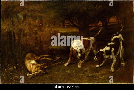 Hunting Dogs with Dead Hare. Artist: Gustave Courbet (French, Ornans 1819-1877 La Tour-de-Peilz). Dimensions: 36 1/2 x 58 1/2 in. (92.7 x 148.6 cm). Date: 1857.  This picture dates to the same year that Courbet debuted his hunting scenes at the Paris Salon of 1857. It invites comparison to the slightly earlier <i>The Quarry</i> (Museum of Fine Arts, Boston) which includes the same pair of hunting dogs, accompanied by a dead stag instead of a hare. The present work was apparently described by the German painter Otto Scholderer (1834-1902), whose studio was above the one Courbet rented in Frankf - Stock Photo
