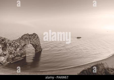 The famous arch rock formation at Durdle Door along the Jurassic Coast basked in sunset light, UNESCO Natural World Heritage Site, Dorset, England, UK - Stock Photo