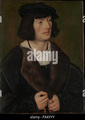 Portrait of a Man with a Rosary. Artist: Lucas Cranach the Elder (German, Kronach 1472-1553 Weimar). Dimensions: 18 3/4 x 13 7/8 in. (47.6 x 35.2cm). Date: ca. 1508.    This painting and a <i>Portrait of a Woman in Prayer</i> (Kunsthaus, Zürich) originally formed the wings of a devotional triptych. The young, well-dressed sitter appears seemingly transfixed by the now-lost central image--perhaps of the Virgin and Child--to which he offers a silent prayer as he pauses on a bead of the rosary held in his hand. The man's ring, bearing the coat of arms of the Dutch families of Six van Hillegom and - Stock Photo