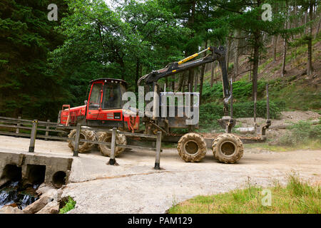 Forestry tractor and trailer used for Logging in the Upper Derwent Valley in the Peak District of Derbyshire - Stock Photo