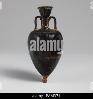 Terracotta amphoriskos (oil flask). Culture: Greek, Attic. Dimensions: H. 6 3/16 in. (15.7 cm). Date: 4th century B.C..  Black-glazed flask with stamped patterns. Museum: Metropolitan Museum of Art, New York, USA. - Stock Photo