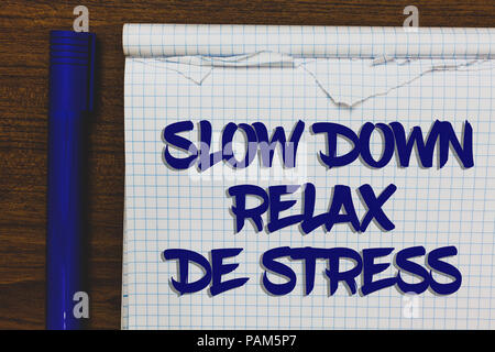 Writing note showing Slow Down Relax De Stress. Business photo showcasing Have a break reduce stress levels rest calm Written white notepad on grey wo - Stock Photo