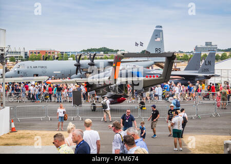 Visitors looking at C-130 Hercules and other air force plane in Farnborough Airshow 2018 in Farnborough, hampshire, United kingdom. - Stock Photo