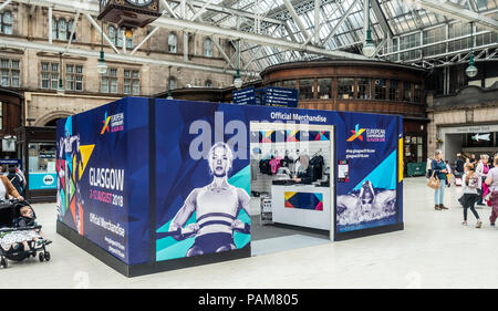 A Official Merchandise shop of Glasgow 2018, the multi-sport European Championships, at Glasgow Central Station covered with branding - Stock Photo