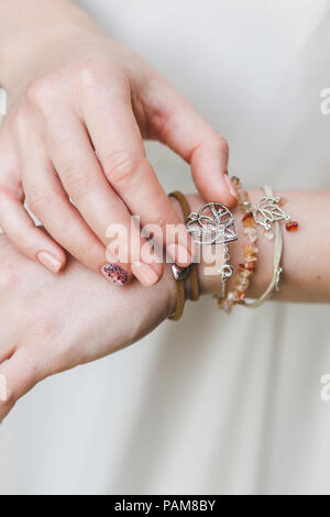 Woman hands with different bracelets and jewellery - Stock Photo