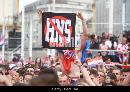 ZAGREB,CROATIA - JULY 15, 2018 :Croatian football fan holding crossed HNS sign during the World Cup 2018 FIFA,Final game on Ban Jelacic Square. Hns me - Stock Photo