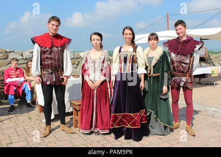 Group of people dressed in historical costumes - medieval festival - Stock Photo