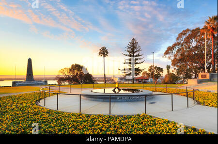 Flame of Remembrance, Pool of Reflection and War Memorial at sunrise in Kings Park, Perth, Western Australia - Stock Photo
