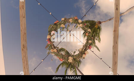 Chandelier of fresh flowers view from below - Stock Photo