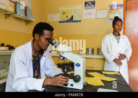 ETHIOPIA Taza Catholic Health Center , laboratory, microscope, checking of bacteria and virus - Stock Photo