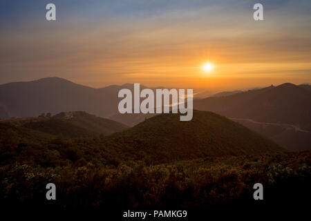 Smoky Sunset over Sierra Foothills, after forest fires near Yosemite National Park - Stock Photo